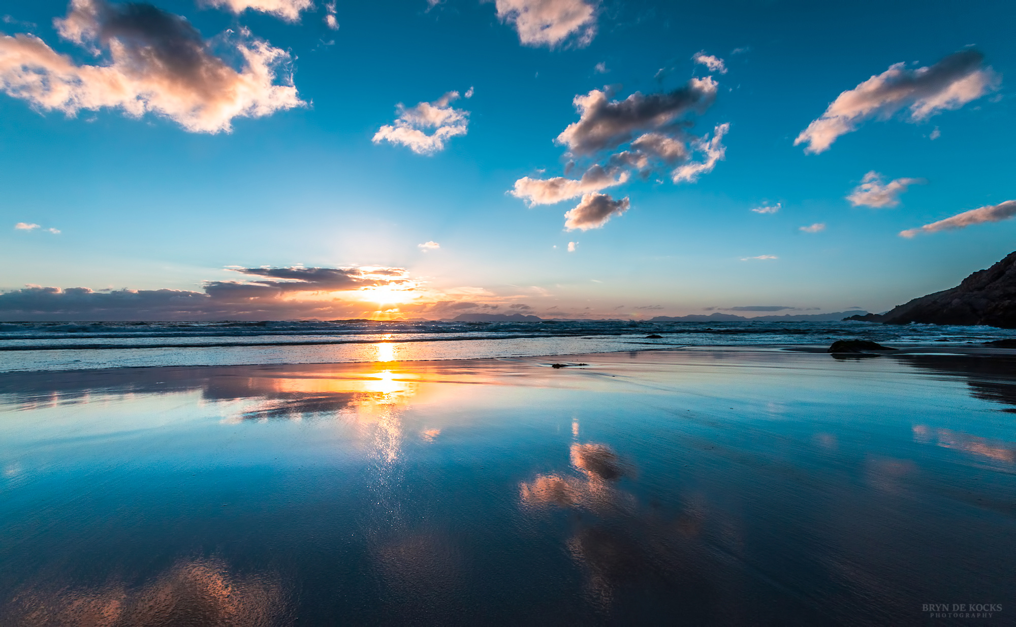 Reflections of clouds at sunset