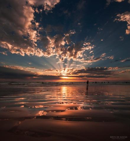 Sun rays at sunset on Strand Beach