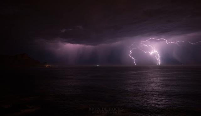 lightening strikes over the ocean