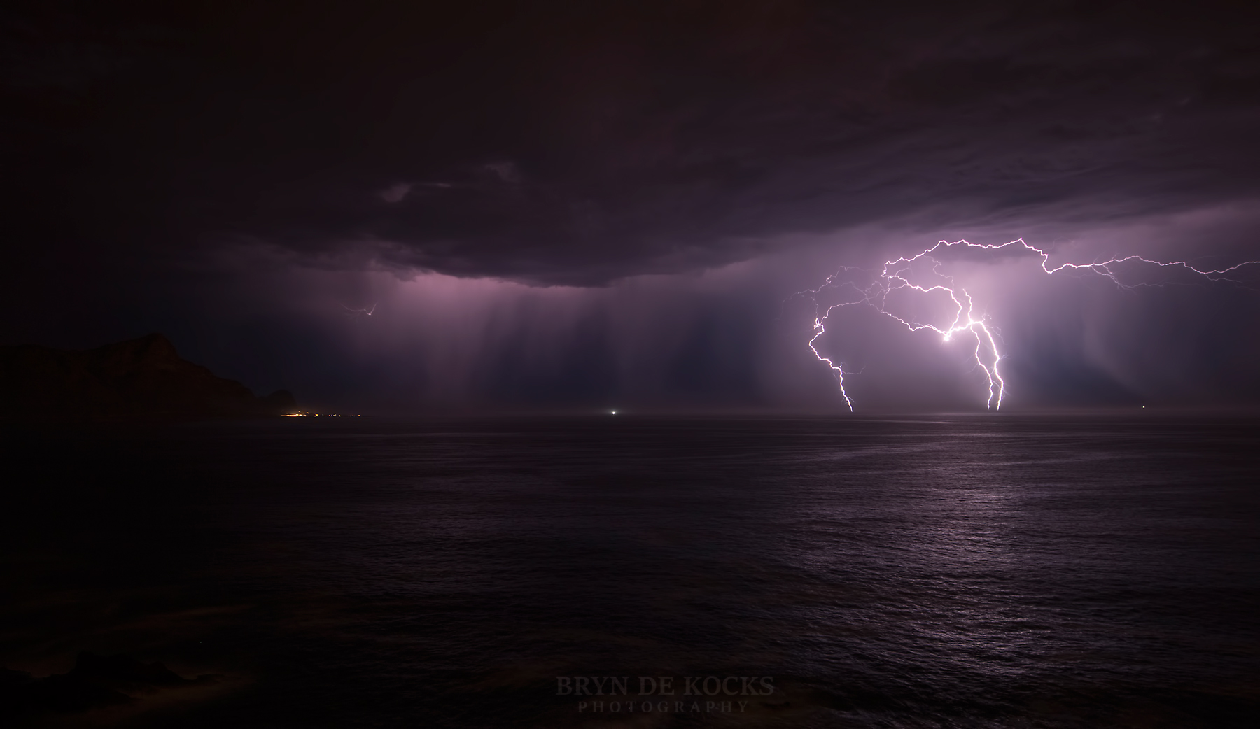 lightening strikes over the ocean