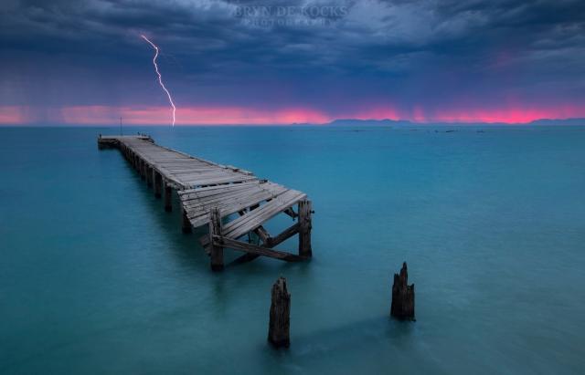 strand lightning sunset