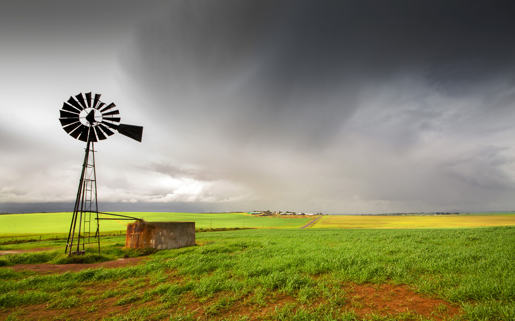 Windmill with storm in the background